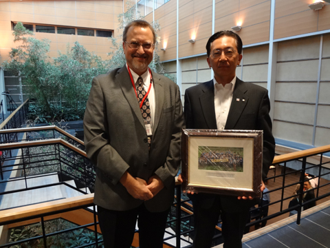 Dr. Christopher Thompson presents Iwate Prefecture Governor Tasso w