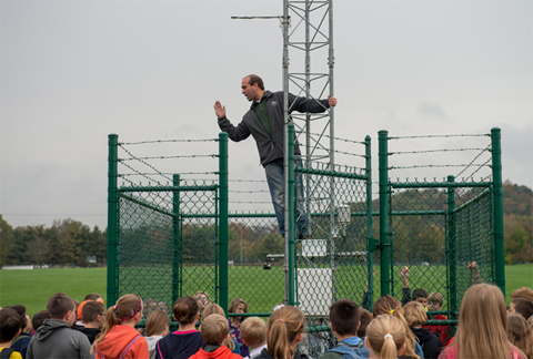 Dr. Ryan Fogt, assistant professor of meteorology and director of OHIO's Scalia Laboratory for Atmospheric Analysis, explains various weather instruments at the University's weather tower to fifth-grade students from Nelsonville-York Elementary School. Photos by Ben Wirtz Siegel
