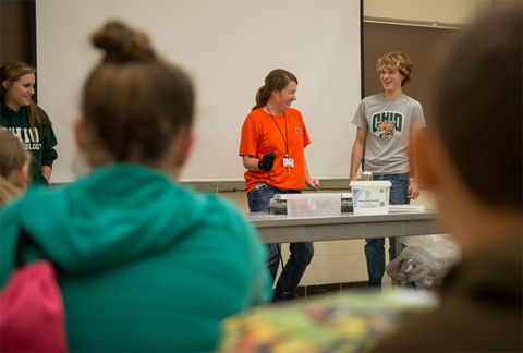 Students studying meteorology at Ohio University assist Nelsonville-York Elementary School teacher Olivia Kittle (center) with an experiment during her class' recent field trip to the University.