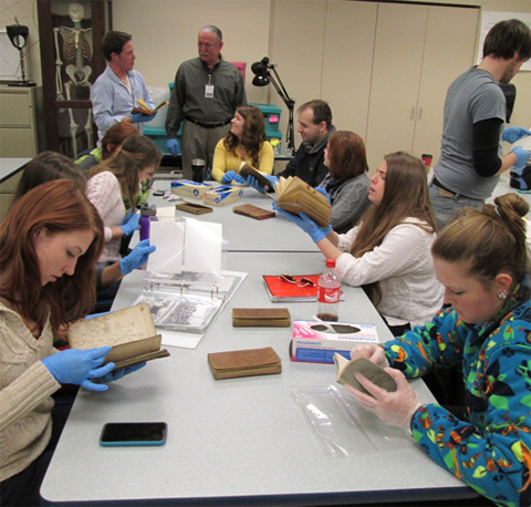 A&S students browse historical documents as part of a collaborative training session between the APHP and ACHSM.