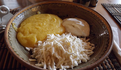 East meets West:  One of the Romanian national dishes – Polenta with fresh sheep's cheese and sour cream.