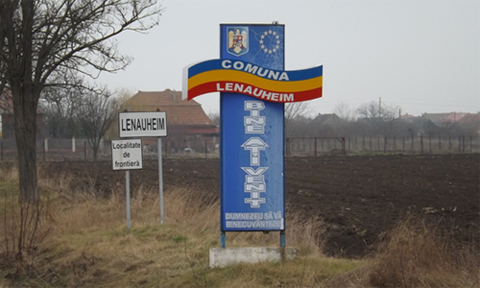 The village of Lanauheim, settled by German colonists in the late 18th century; The Germanic place name contrasts with the Latin-based Romanian welcome sign.