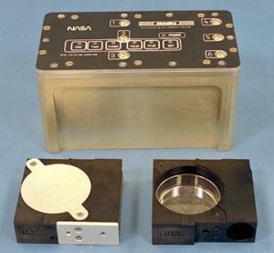 Figure 1 – A sealed BRIC unit with two PDFU units – one sealed and the other open with its petri dish (or plate) contents exposed (Photo: NASA)