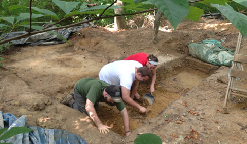 Working side at the excavation site by side are left to right Nicholas Stillman, Jonathon Yochum, and Natasha Cromwell.