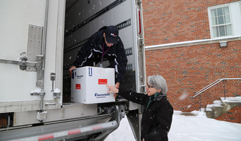 Unloading the FedEx truck in the snow.