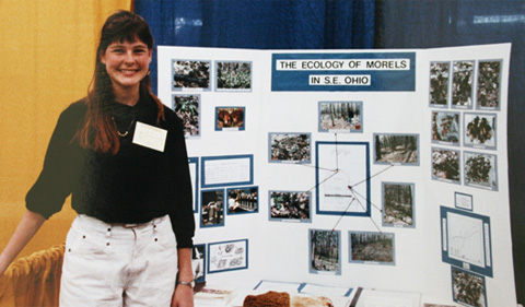 """""""One of the best ways to discover science is to go OUTSIDE and just be CURIOUS,"""" writes Nicole Cavender, pictured here at the regional science fair in the early 1990s. She participated in WISE as a young person, won a scholarship at the regional science fair and went on to the International Science and Engineering Fair. [Photo: provided by James Tong]"""