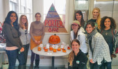 """The BEEP Lab team poses with their pumpkin display entry, """"A Balanced Porter Diet."""""""