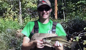 Jackie (Smith) Kloepfer holding holding a small mouth bass in Sharps Fork