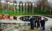 Students visit the Omagh bombing memorial site with Michael Gallagher, chairperson of the Omagh Self Help and Support Group. Gallagher advocates nationally and internationally for a public inquiry into the bombing.