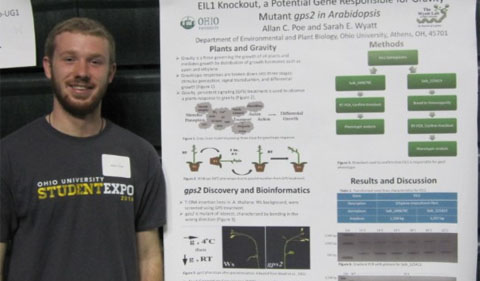 Plant Biology Undergraduate student Allan Poe presents his poster at the Expo.