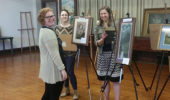 Harlee Rozell with Hailee Fouch and Jessica Cydrus setting up art exhibit at Federal Valley Reserve Center April 14, 2016.