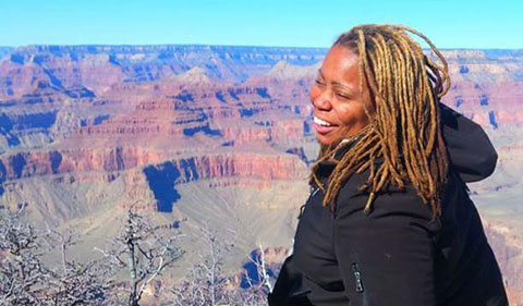 Sydney Epps at the edge of the Grand Canyon