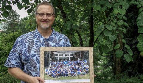 Thompson with a photo taken of participants in the 2015 September edition of the OHIO-IPU Tsunami Relief Project.
