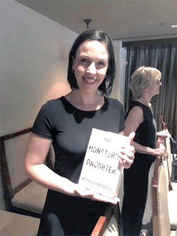 Michelle Pretorius at the Melville House Bookseller's Dinner, where she holds the hardback copy of her debut novel for the first time