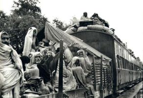 Image of displaced people aboard train