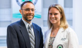 William Nitardy, M.D., presents a plaque to Rebecca Hayes, M.D. Photo by Marshall University.
