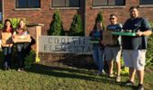 Graduate students Proma Basu, Emily Keil, Laura Mason, Danny Wolf, and Joshua Evans stand outside the Coolville elementary.