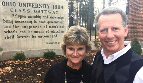 Steve Ellis, right,and his wife in front of the Alumni Gate at Ohio University