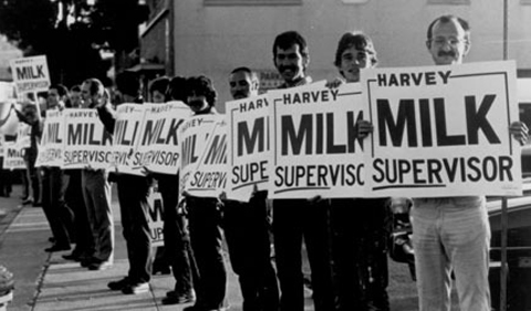 Photo from the film The Times of Harvey Milk, showing protestors holding signs saying Harvey Milk Supervisor