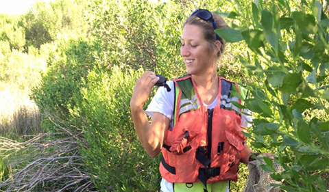 Part of Tokash's duties included gathering data and tagging hatchlings. She's shown with traps, holding a turtle.