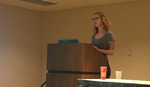 Babz Jewell behind podium presenting research at the American Society of Criminology