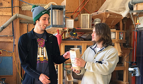 Students Jacob Ballas, and Sam Heckle share samples of the products produced in-house at the Mill. Students were shown how a variety of products can be produced in the milling process.