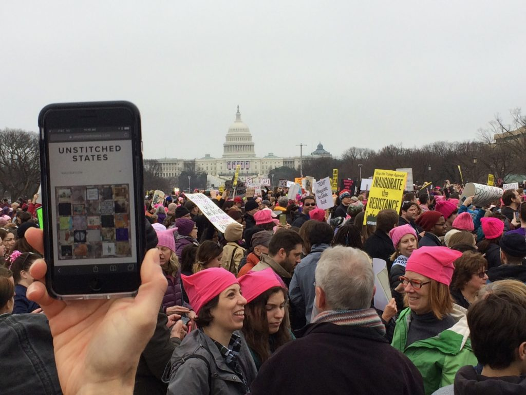 Phone, large crowd, Capitol building