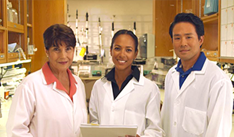 Quidel employees in the lab in white coats
