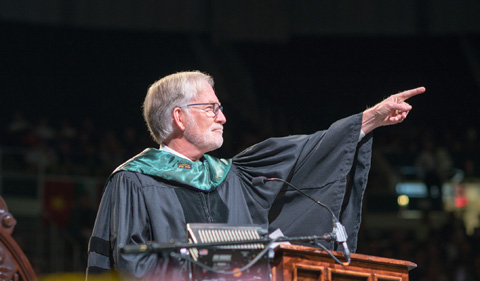 OHIO alum David Crane speaks at gradatue commencement after receiving an honorary doctorate degree from Interim President David Descutner. Photo by Ben Siegel