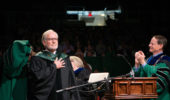 OHIO alum David Crane receives an honrary doctorate degree from Interim President David Descutner. Photo by Ben Siegel