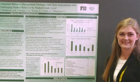 Jessica Smith presents a research poster at the Association for Behavioral and Cognitive Therapies (ABCT) convention, shown here standing by her poster.