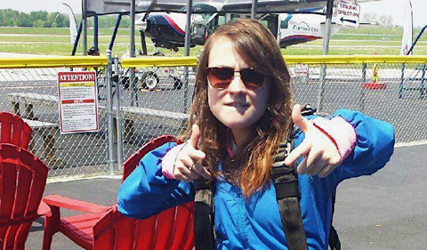 Psychology student Megan Credit, wearing parachute harness at airfield