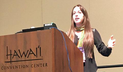 Anne Sternberger at podium at Hawaii conference