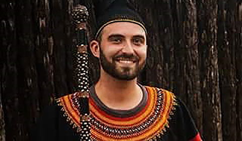 Sean Potts in March 2016 in traditional Kenyan dress at the Guzang Queen Mother's funeral.