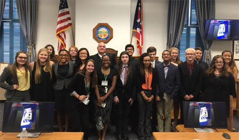 Students pose with Judge George P. McCarthy in his Athens courtroom.