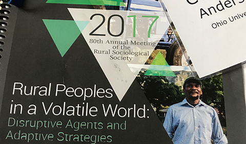"""cover of program for the 2017 annual meeting of the Rural Sociological Society, """"Rural Peoples in a Volatile World"""""""