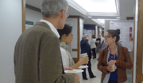 Foreground: Anne Sternberger, Ph.D. student, presents research to alumni Drs. Thomas and Chenzhao Vierheller