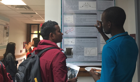 Doctoral Student Mongi Dlamini (R) presented Deeply Virtual Compton Scattering at Jefferson Lab Hall A.