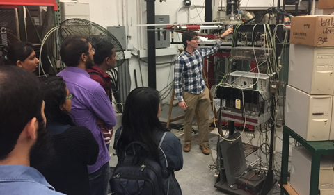 Dr. Zach Meisel points out some of the detectors that are used in the experiments carried out at Edwards.