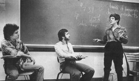 An OPIE class in the 1970a, black and white photo with teacher and three students.
