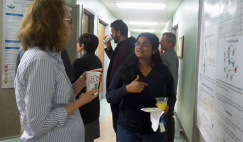 Proma Basu, Ph.D. student, discusses her research poster with Assistant Professor Elizabeth Hermsen. Basu presented her research at the American Society of Plant Biologists in Hawaii in June.