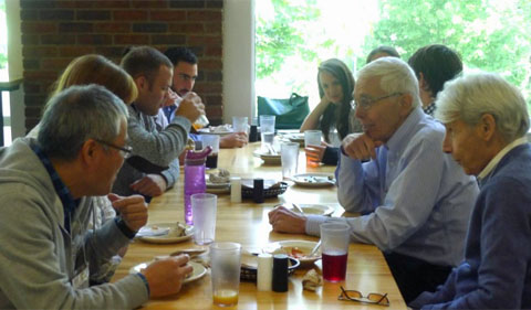 Participants continue the discussion at lunch.