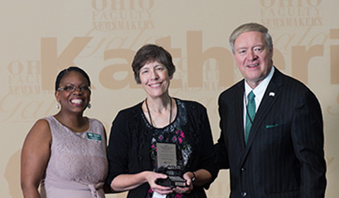 President M. Duane Nellis and Chief Marketing Officer Renea Morris pose for a photo with this year's top OHIO faculty newsmakers, Dr. Katherine Jellison, who was featured in 1,031 media reports in calendar year 2016.