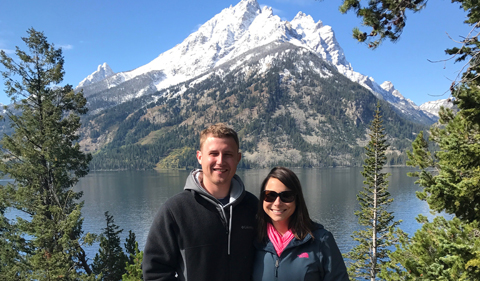 Jake Robertson with his wife, in the mountains, with snow on top