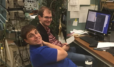 University of Notre Dame Postdoctoral Researchers Patrick O'Malley and Axel Boeltzig use ROOT, a C++ software developed for plotting and analyzing data, to inspect a 2D spectrum of time-of-flight vs. energy of the charged particles seen by their detectors.