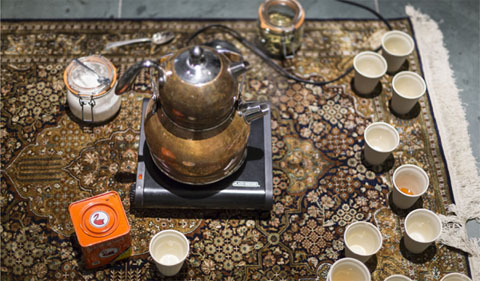 Tea project, with plastic cups on rug. art of the Material Histories: Cultures of Resistance Exhibit