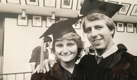 Traci and Steve Ellis at their graduation, wearing cap and gowns