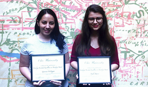 From left, Genoveva Di Maggio and Angela Romero, shown here holding their certificates