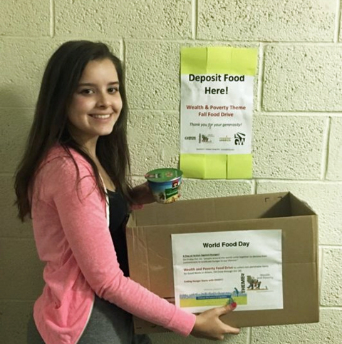 Lauren Conner with her food drive box