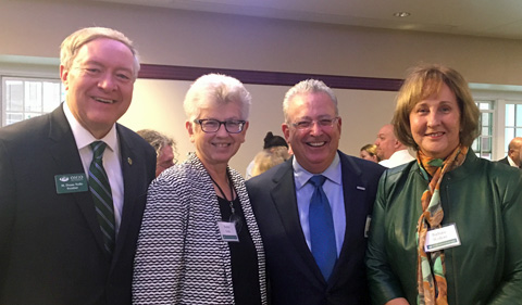 President M. Duane Nellis, Ruthie Nellis, David Wolfort and Barbara Wolfort. Shown in a group photo..